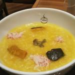 119246350 - かぼちゃとカニの黄色いお粥