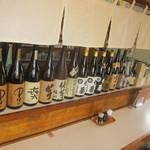11943293 - 焼酎の瓶が並んだカウンター