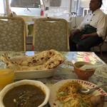 ザイカ・カレーハウス - スープのお茶わんオーナーさんの趣味かなぁ〜? 仕事の終えたオーナーさん! マッタリ休憩中!^_^ 衛星放送でお国?のテレビ見てます^_^