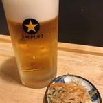 昇龍 - 生ビール中(560円)とサービスお通し