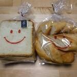 ベーカリーじゅりあん - 料理写真:バゲット(スライス済)と、発芽玄米食パン(6枚切り)