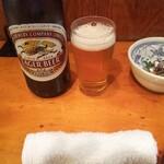 120452879 - 瓶ビールにお通しが きびなご刺