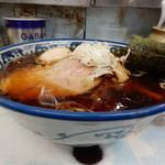 120602669 - 醤油色の濃いスープ