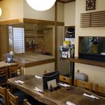 12087667 - 蕎麦打ち台とテーブル席