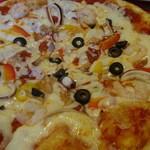 イルボスキーノ - 魚介のピザ