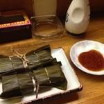 かっぱ - 笹の葉に包まれた慣れ寿司