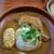 ハイダル - 料理写真:薬膳ローストチキンカレー。お皿の左側は、ゆで玉子をスライスしたものです。
