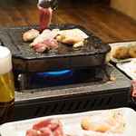 日本酒ダイニング 吉之助 - 名物「溶岩焼き鶏」
