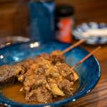 串焼き 巴 - 料理写真:2019.12 もつ串煮込み(350円)