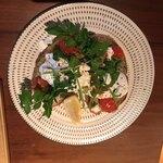 121910930 - ボーチドエッグとアボカドマリネのライ麦トースト