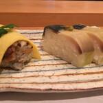 122343268 - 鯖の棒寿司とちらし寿司、個性派です
