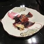 122554810 - 秋刀魚の骨焼き煎餅。