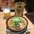 テング酒場 - 赤星大瓶550円とモツ煮込み360円(税別)