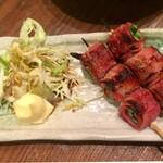 もつ焼き 稲垣 - 緒方焼き 2本 400円