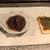 縁伝 - 料理写真:ホタルイカの沖漬けとクラッカーに何か乗った物