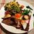 クレープリー エ ビストロ アルモリカ - 料理写真:なんて華やかな盛り付け!ハーフ&ハーフのガレット、右側は帆立貝柱のサンジャック、左側は牛ひき肉とナスのカレー