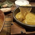 124038528 - カレーつけ麺の麺リフト