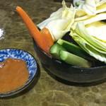 12406434 - お通しのキャベツ; 辛味噌をつけて食べると美味しいですね...