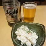124065197 - 瓶ビール・ポテサラ