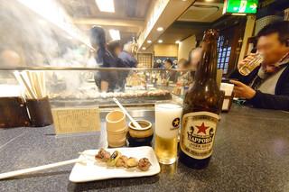 かしら屋 - 大瓶ビール580円(税抜)
