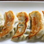 中国飯店真味 - 料理写真:自家製肉汁焼き餃子