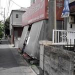 ニューラーメンショップ ドモン - 店舗入口