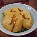 ずくや昌楽 - ファミリー客のお父さんが食べていたグリーンラーメン