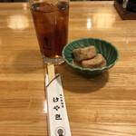 124834014 - ウーロン茶220円、お通し210円。※税込み