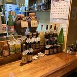 海人居酒屋 源 - 泡盛呑み比べ700円!その数30種類以上!レアな古酒や泡盛から3種選んで呑み比べ!