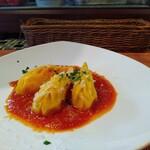 125211796 - 鱈とじゃが芋を詰めたサフラン生地のクルルジョネス トマトのズッペッタ