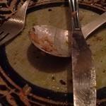 Furenchishokudoubudou - 「スズキのポワレ、リゾット添え」・・・・・の食べた後の皿....。