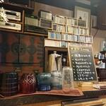 125265108 - 【カウンター席からの眺め】                       古そうな和箪笥や階段箪笥が自然に溶け込む空間。                       ケーキの種類が多いですよね( ☆∀☆)