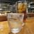 魚虎 - ドリンク写真:芋焼酎 遠賀の赤芋(ロック) 650円と、ウーロン茶 350円(同グラスで2杯目から無料)