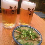 12546249 - 煮込み(525円)ビール(630円)