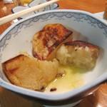 12567175 - 食べかけのじゃがバターです。