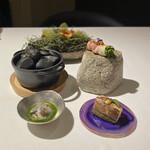 125735595 - ガレット、野菜の肉巻き、イカスミコロッケ、バージンオイスター、穴子