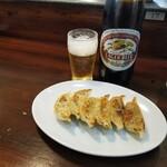 125969936 - 餃子とビール