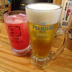 126273671 - 生ビール200円とトマトサワー200円