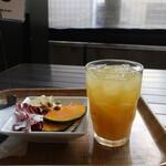 127204686 - オレンジジュースとミニサラダ