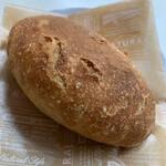 127586516 - マカダミアのパン   240円(税抜)