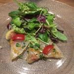 127626860 - 白身魚の刺身サラダ葱生姜風味(パクチーなし)