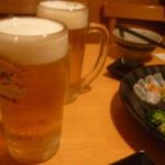 居食屋 くし坊 - 生ビール中キリン一番搾り(二人で何杯飲んだか覚えてません)