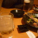 居食屋 くし坊 - 黒糖焼酎朝日水割り一杯目