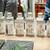 串天ぷらとSAKE 日本酒原価酒蔵 - メニュー写真:100mlの小瓶に詰まった日本酒