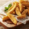 パニックバーガー - 料理写真:クリスピーなガーリック風味のウェッジポテトです。外はカリカリ、中はホクホク。
