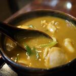 128643465 - カレーと出汁がきいたスープ