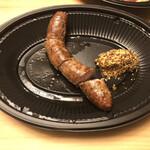 カフェ ラ・ボエム - 黒胡椒風味の極太ソーセージ