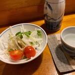 山き - 山き@八戸(れんさ街) お通しのサラダと熱燗