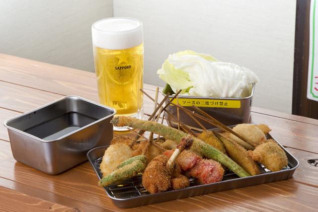 西日暮里酒場 串まる - 秘伝のソースでアツアツを!ビールに最高。30種以上一本90円~