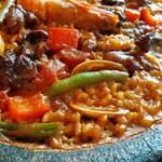 130011561 - 濃厚魚介エキスと牛すじのコクがお米1粒1粒にしみ込む!鍋のフチの香ばしいおこげも絶妙